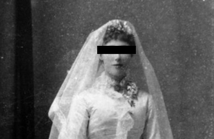 Black and white photo of a Victorian/Edwardian era bride; her eyes redacted with a black rectangle