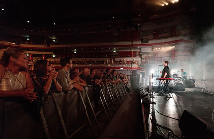 Side view of John Grant on stage at Birmingham's Symphony Hall