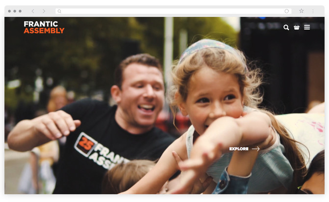 The homepage of Frantic Assembly's new website, shows a still from their 25th birthday celebrations video. A man in a Frantic t-shirt is visible behind a young girl being held aloft with her arms outstretched and a big grin on her face