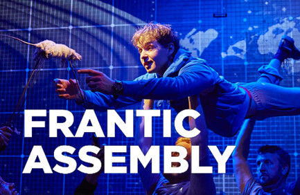 Still from The Curious Incident … with a character held aloft by 'invisible' cast; arms outstretched towards a puppet mouse. Frantic Assembly's logo's sat over the image