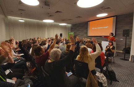A presenter asks a room full of people 'Who has a Support Us page?' and everyone has their hands up