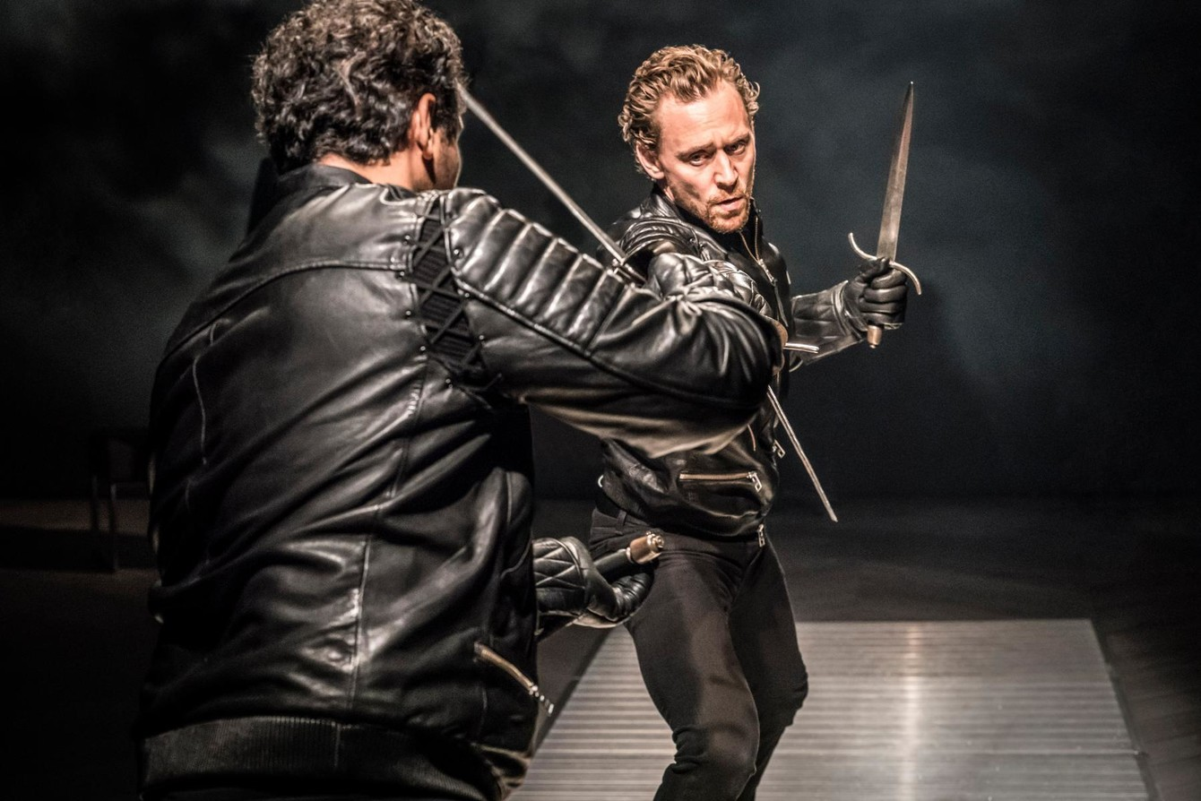 Tom Hiddleston as Hamlet, fighting with someone we can only see the back of